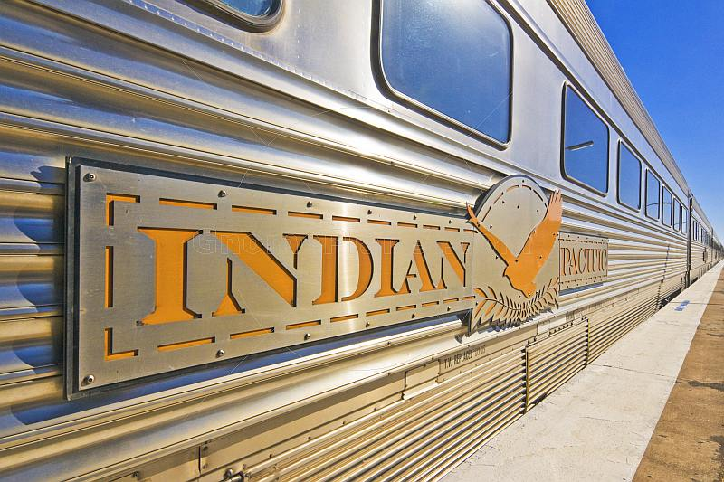 Indian Pacific signboard and logo on carriages at Broken Hill railroad station.