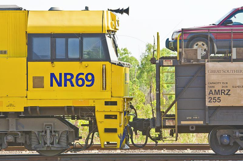 Yellow GSR Cv40-9i locomotive and car transporter at Alice Springs railway station.