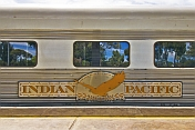 'Indian Pacific' coach with tree reflections in the windows