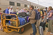Passengers retrieve luggage at Alice Springs station