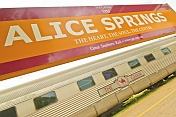 Alice Springs station nameboard over Ghan carriages