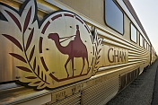 Ghan logo and nameboard on carriage at Alice Springs station