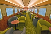 Easy chairs and tables in 'Red Gum' lounge car