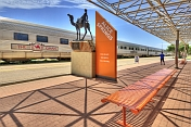 Camel memorial and Ghan train carriages at Alice Springs station.