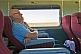 Passengers doze in Indian Pacific Day-Nighter seats crossing the Nullarbor Plain.
