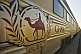 Ghan train camel logo and carriages at Alice Springs railway station.