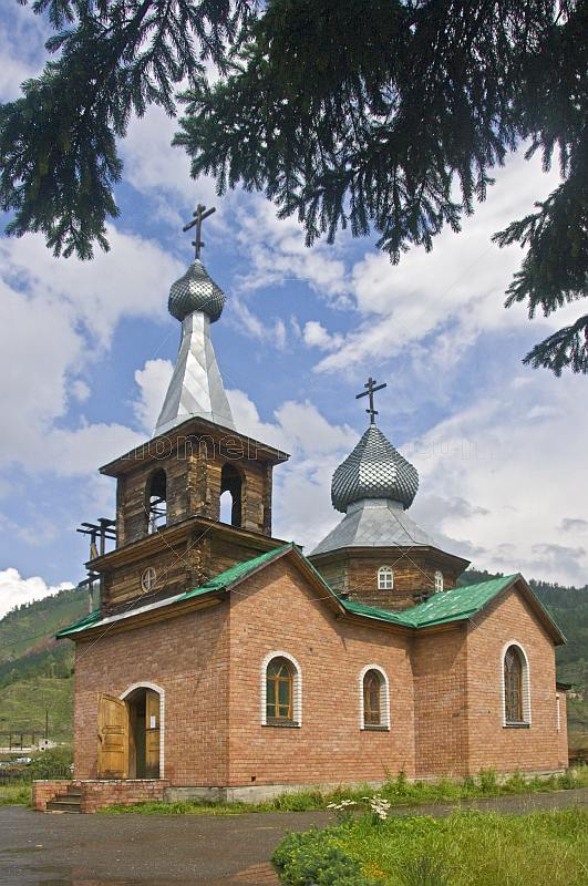 Brick-built Russian Orthodox church with onion domes.