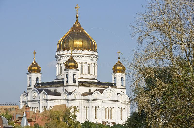 The gold-domed Cathedral of Christ the Saviour stands next to the Moscow River.