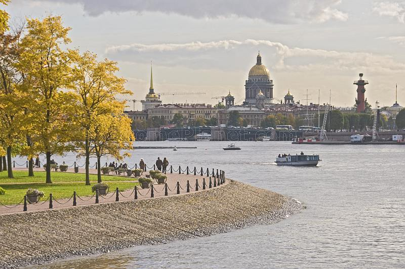 Saint Isaacs Cathedral and the Admiralty Buildings overlook the Dvortsovy Bridge and the River Neva.
