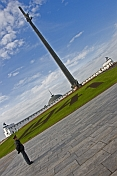 A Russian policeman patrols in front of the 142m Obelisk in Victory Park, near the Museum of the Great Patriotic War.