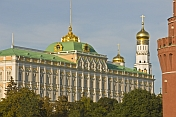 Green copper roofs and golden domes of the Great Kremlin Palace.