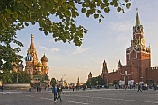 Crowds wander past St. Basils Cathedral and across Red Square in the evening sunshine.