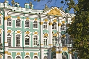caption: Green and white stucco-work of the Admiralty Buildings, by the River Neva.
