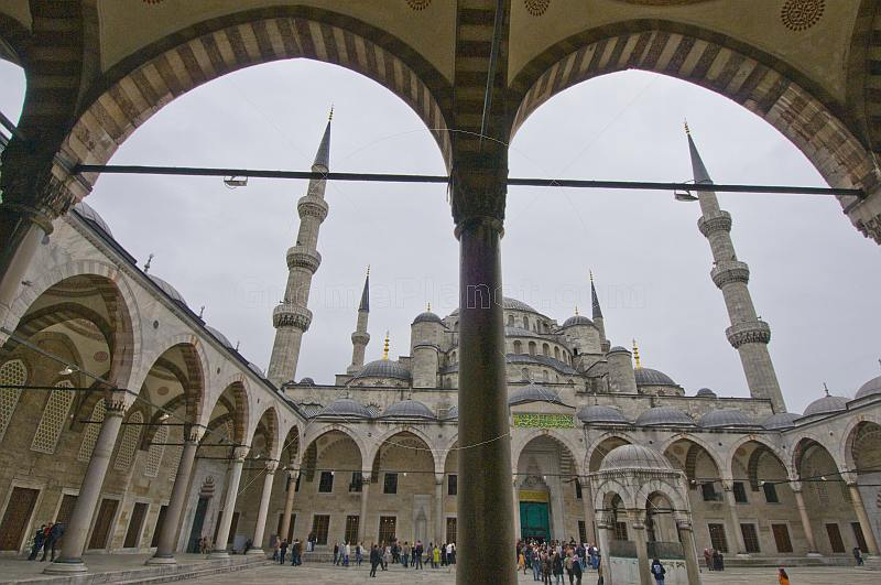 A crowd of tourists visit the courtyard of the Sultan Ahmet Camii, or Blue Mosque, in Sultanahmet.