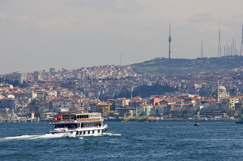 A ferry boat crosses the Bosphorus, heading for Uskudar, on the Asian side.