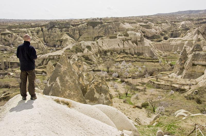 A male tourist surveys the valley of caves near Goreme.