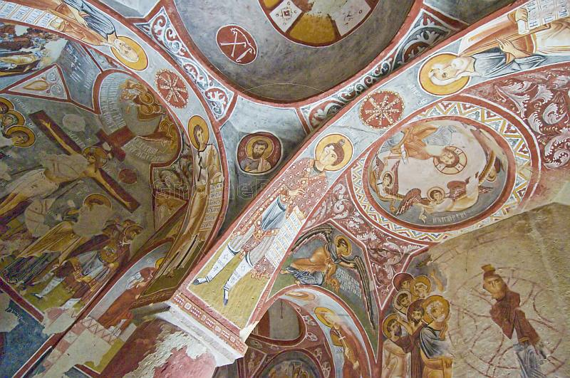Desecrated Christian paintings in an ancient church carved out of a cave.