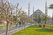 Young couple walk towards the Aya Sofya in Sultanahmet.