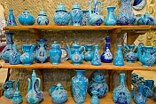 A display of local blue pottery jugs and plates in a cave workshop near Goreme.