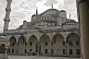 Courtyard, roof, and minaret of Sultan Ahmet\\'s blue mosque in Sultanahmet.