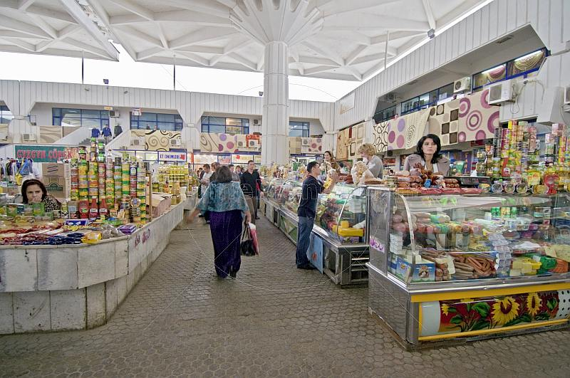Shoppers and stall holders in the central covered produce market.