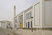 A solitary Turkmeni woman walks in front of the Ruhy Mosque, the biggest in Central Asia.