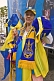 Woman sells yellow and blue memorabilia on Ukraine Independence Day.