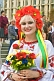 Ukrainian woman in national dress holds flowers on Independence Day.