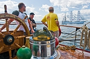 Captain and crew watch the tallship 'Sagres' from the quarterdeck of the 3 masted barque 'Picton Castle'.