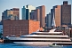 Luxury cruiser 'Odyssey' sails through Boston harbor in late evening.
