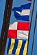 Colorful signal flags on rigging of the Russian square-rigger 'Kruzenshtern'.