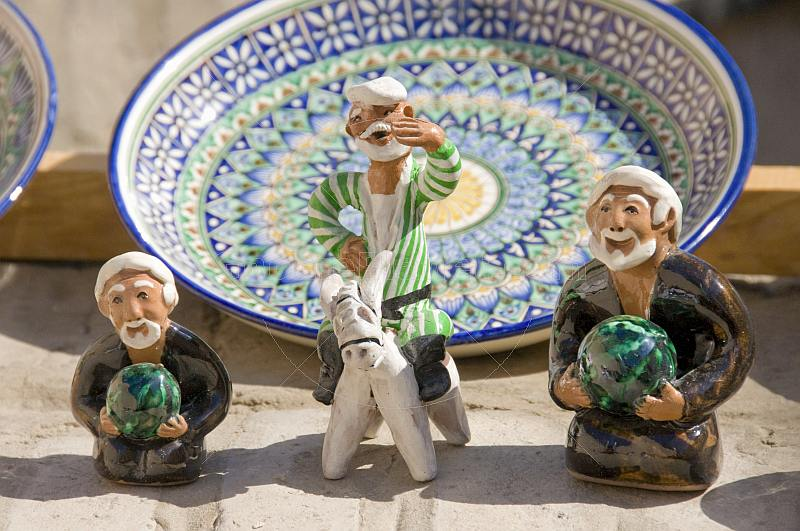 Plate and two ceramic figures reflect the craftsmanship of the Silk Road potters.