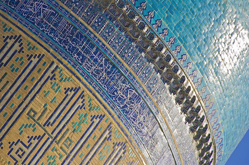 Sunshine reflects off the luminous blue tilework on a dome of the Miri-Arab Madrassah.