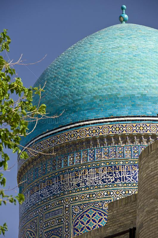 Blue dome and tile-work on the Mir-I-Arab Medressa.