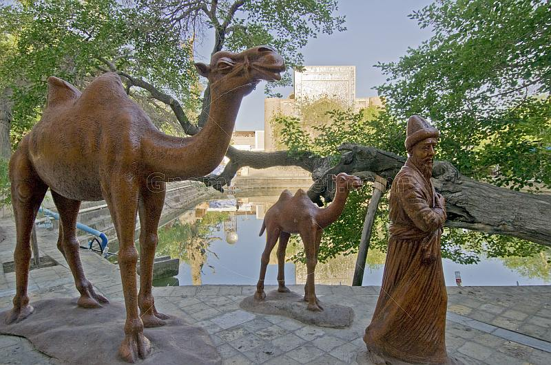 Statues of nomad and camels in front of the Lyabi Hauz pool.