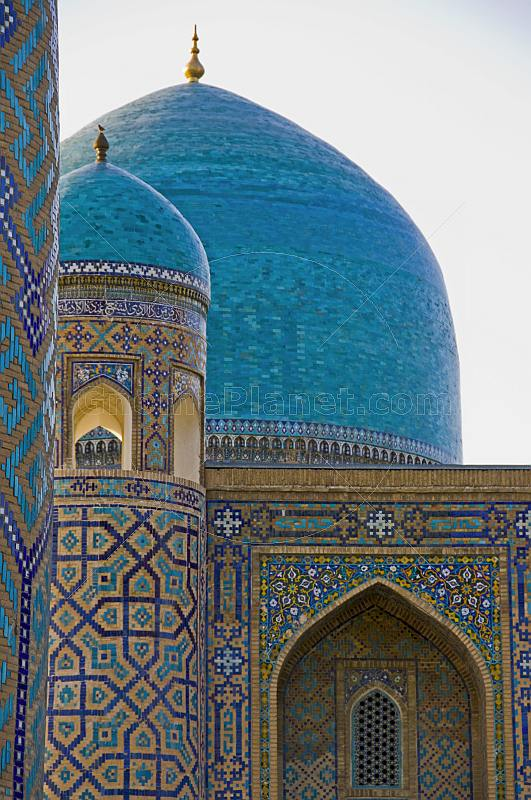 Blue-tiled domes of the Tilla-Kari Medressa, part of the Registan.