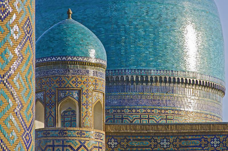 Blue-tiled domes of the Tilla-Kari Medressa.