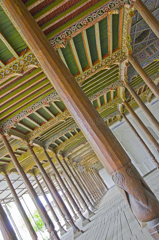 Carved pillars and painted wooden ceiling in the Juma Mosque (Friday Mosque).