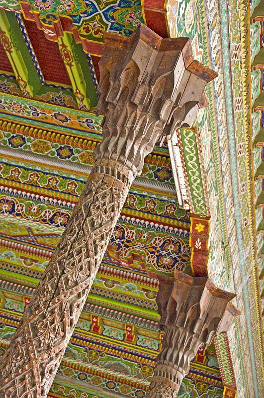 Intricately carved pillars and painted wooden ceiling in the Juma Mosque (Friday Mosque).