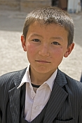 Young Uzbek boy in a suit.