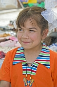 Young Uzbek girl in orange teeshirt.