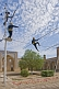 Circus Highwire Walkers perform in the courtyard of an old madrassa.