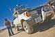 Image of Man loads luggage on a Toyota 4WD Land Cruiser prior to crossing salt flats.