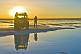 Image of Man with Land Rover viewing the sunset on the Uyuni Salt Flats.