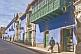 Man walks past the Hostal Las Tres Portadas on Calle Bolivar.