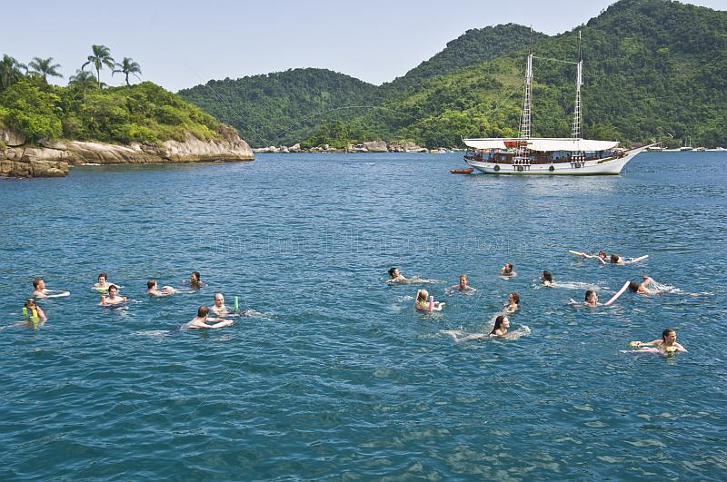 People swiming in the waters of the Bahia Da Ilha Grande.