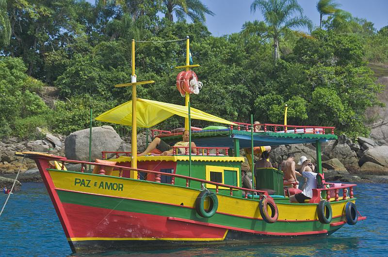 Colorful bathing boat in the waters of the Bahia Da Ilha Grande.