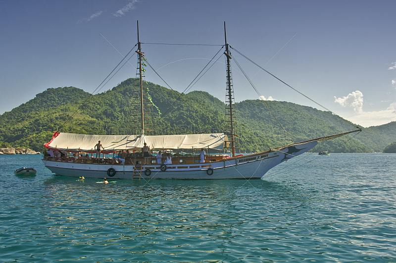 Swimming from a schooner in the waters of the Bahia Da Ilha Grande.