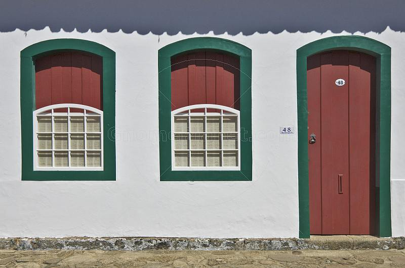 Colorful colonial house door and windows.