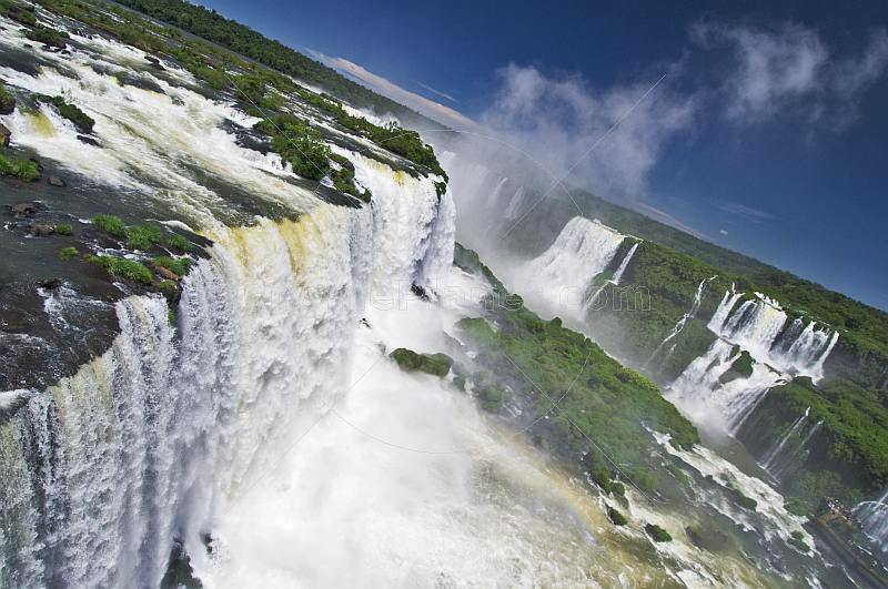Water cascading over the falls and iinto the Iguazu River.